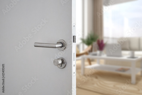 Fotografía  Door handle , door open in front of blur interior room background, selective foc