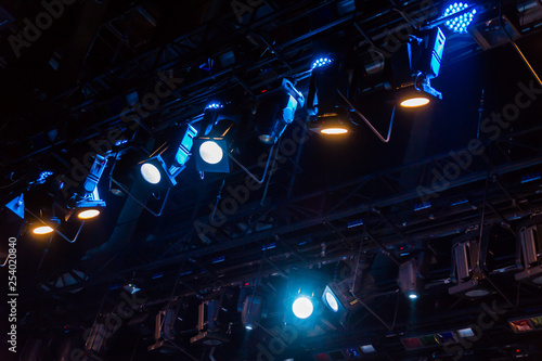 Lighting equipment on the stage of the theater or concert hall. Rays of light from the floodlights. - 254020840