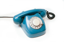 A Blue Old Retro Rotary Mechanical Phone Isolated On A White Background.