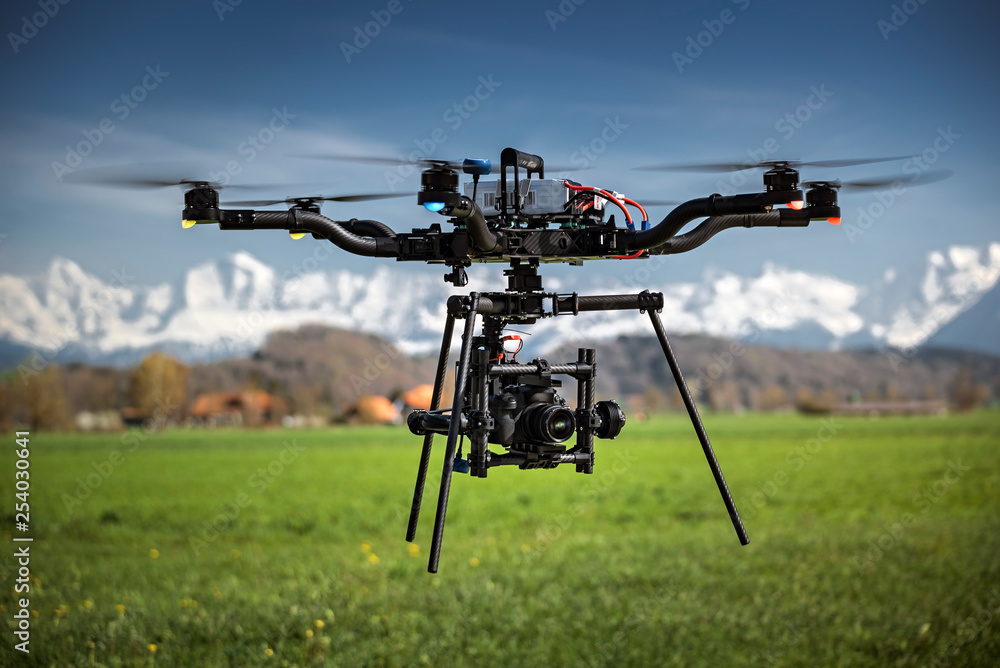 Fototapety, obrazy: Big professional camera drone in mid-air