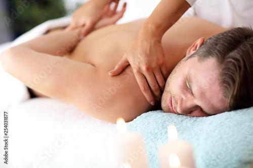Photo sur Toile Pain Handsome man having massage in spa salon