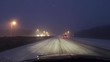 Car driving (drivers point of view) on a highway during a snow storm - winter season.