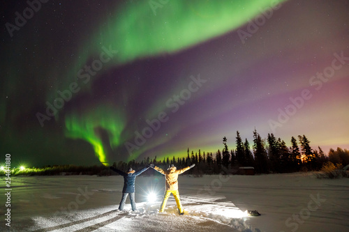 Poster Taupe Two people Traveler in light projector on background iridescent sky