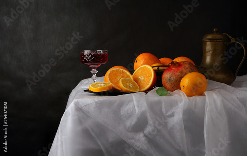 Fototapeta Still life in retro style with a glass of wine, a jug and fruit obraz