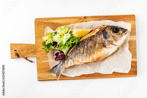 Fotografie, Obraz  baked fish dorado with salad