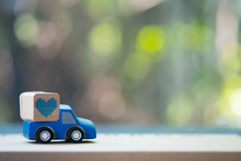 Toy Blue Pickup Truck Delivering Blue Heart