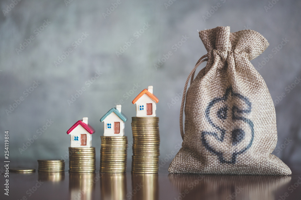 Fototapeta  planning savings money of coins to buy a home, concept for property ladder, mortgage and real estate investment. for saving or investment for a house