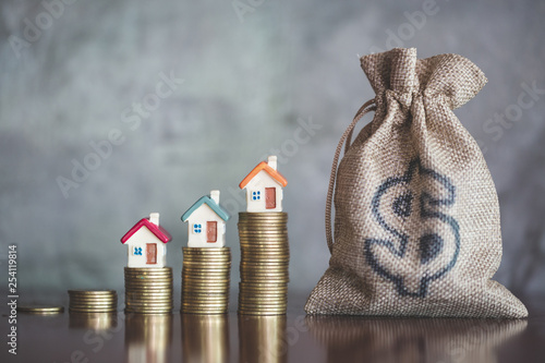 Obraz  planning savings money of coins to buy a home, concept for property ladder, mortgage and real estate investment. for saving or investment for a house - fototapety do salonu