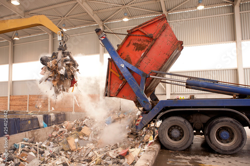 Photo  Truck dumps waste to the incinerator, hole where the big grab take the rubbish and put it into fire