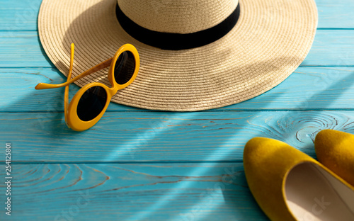 Canvas Prints Countryside Women's accessories - shoes, hat and sunglasses of yellow color.
