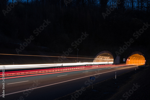 Papiers peints Tunnel Highway tunnel at night and light trails of vehicles in Germany