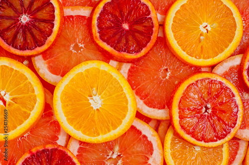 Keuken foto achterwand Plakjes fruit Different kinds of oranges and grapefruit slices background