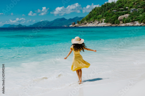 woman relax on tropical beach resort with ocean view
