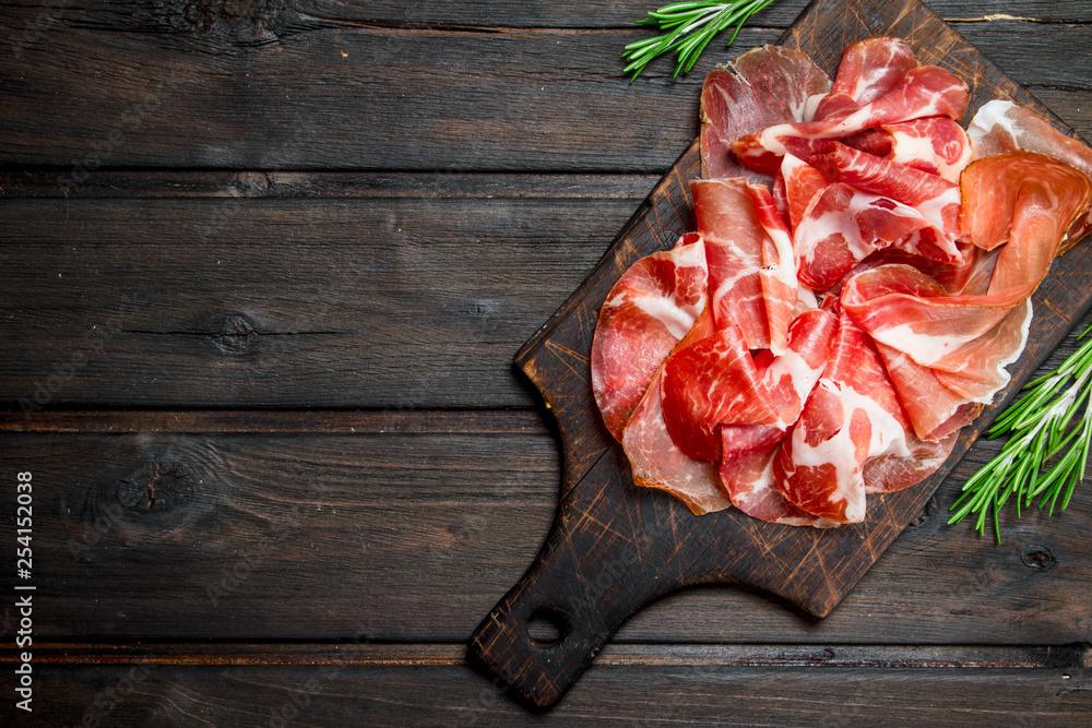 Fototapety, obrazy: Spanish ham on the chopping Board.