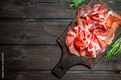 Spanish ham on the chopping Board. Wallpaper Mural