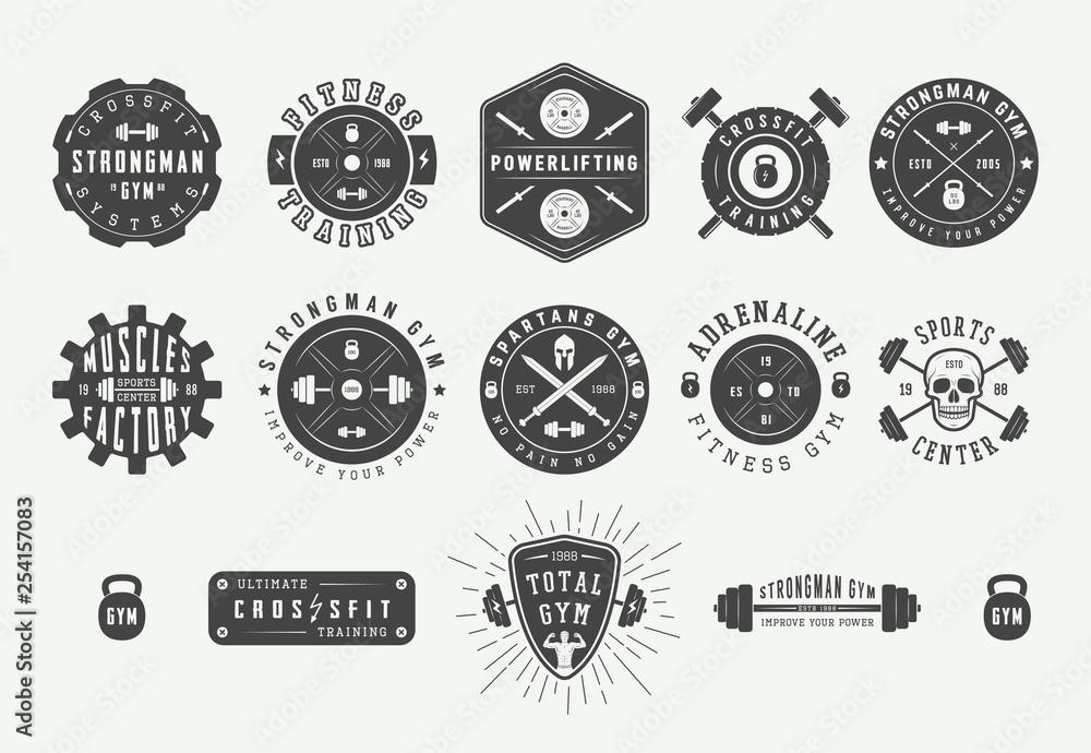 Set of vintage gym fitness logos, emblems, badges, labels, marks and design elements. Retro graphic art. Vector Illustration.