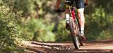 Mountain biker riding on bike singletrack trail, mountain bike race