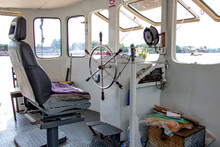 The Wheelhouse On A Ferry Boat In Thailand. The Empty Control Cabin On Ship On The Chao Phraya River In Bangkok.