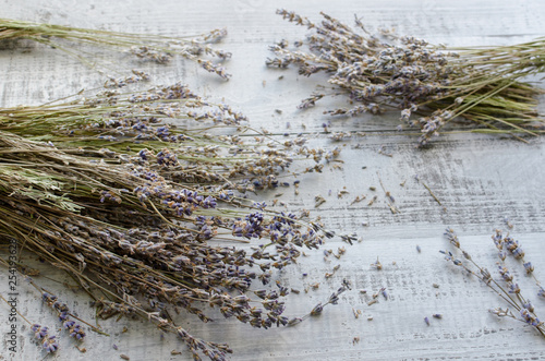 Valokuva  dry lavender flowers on a wooden board