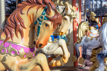 Horses On The Old Children's Circular Carousel.