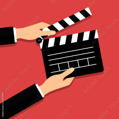 Valokuva Black opened clapperboard in hands
