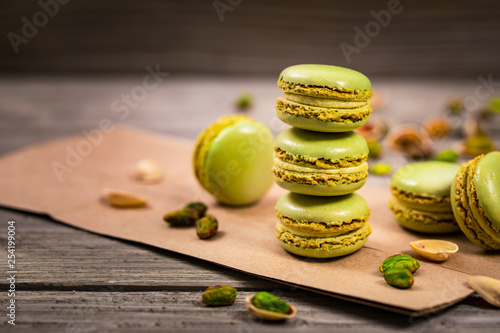 Poster Macarons Green Pistachio Macaron Cookies Background. Selective focus.