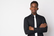 Portrait of young African businessman with arms crossed