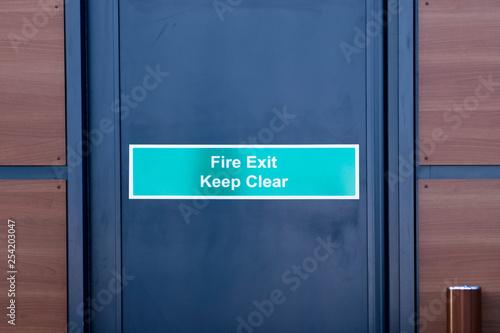 Fotografie, Obraz  Fire exit keep clear sign on black door