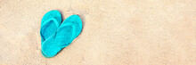 Blue Pair Of Flip Flops On The Beach, Panoramic Summer Concept