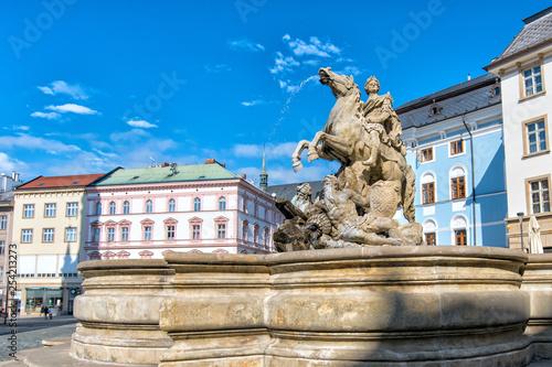 Fotografía  Caesar fountain against the blue sky in Olomouc. Czech Republic