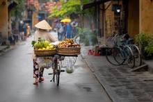 Woman Walking In Hoi An With F...