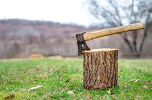 Wooden Hand Ax With Iron Blade Stabbed Into The Stump