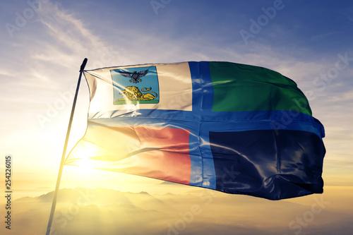 Belgorod oblast of Russia flag waving on the top sunrise mist fog Wallpaper Mural