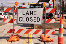 Lane Closed Sign At Messy Cons...