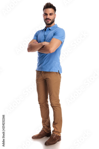 confident man standing with his hands crossed