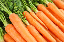 Ripe Fresh Carrots As Background, Space For Text