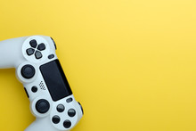 Joystick On Yellow Background, Isolated Close-up. Copy Space For Text.