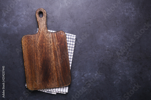 Dark stone table with cutting board and linen napkin Copy space Canvas-taulu