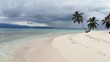 aerial low flight ascent over tropical island beach and ocean in San Blas islands Guna Yala Panama