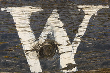Distressed White Letter W Painted On Wood