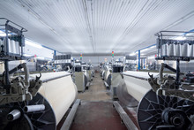 Interior Of Textile Factory With Automated Machinery.Concept Of Industry And Technology.