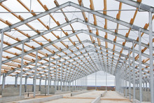 The Construction Of The New Barn. Wooden Beams On A Metal Frame. Construction Of Agricultural Buildings. The Construction Of The Barn. Agriculture
