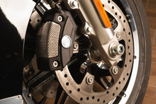Front Fork Of A Motorcycle With A Front Wheel, Brake Disc, Brake Cylinder. Close Up. Soft Focus