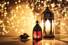 Ornamental Arabic Lanterns With Burning Candles. Glittering Golden Bokeh Lights. Plate With Date Fruit On The Table. Greeting Card For Muslim Holiday Ramadan Kareem. Iftar Dinner Background.