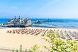 Sandy beach and famous Sellin Seebruecke (Sellin Pier) in summer, Ostseebad Sellin tourist resort, Baltic Sea, Germany