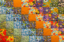 Quilt, Fabric Texture With Flowers And Geometric Patterns. Floral Textile Background