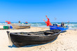 Fishing boats on sandy beach in Baabe village, Ruegen island, Baltic Sea, Germany.