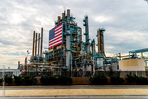 Photo Large American Flag affixed to oil refinery