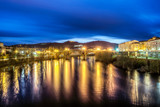 Roman bridge illuminated at night in Ourense