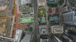 day time flight over hong kong city downtown traffic streets aerial topdown panorama 4k